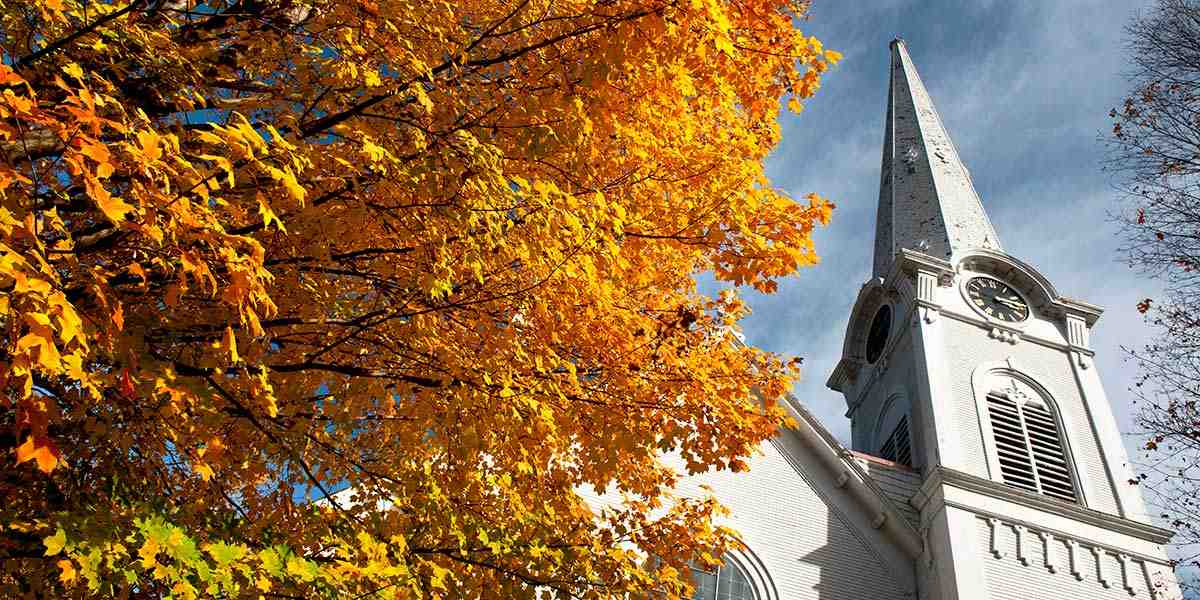 Church steeple and yellow trees - Vermont Department of Tourism and Marketing
