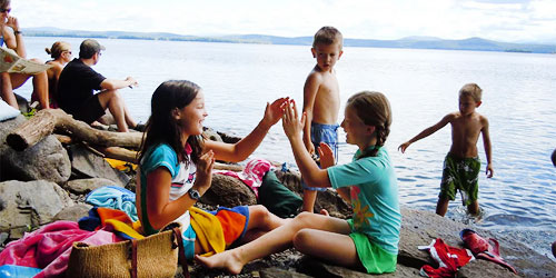 Grand-isle-girls-playing-lake-credit-VT-State-Parks