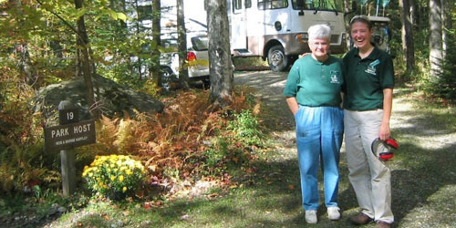 Quechee-state-park-women-with-camper-in-background-credit-vtstateparks
