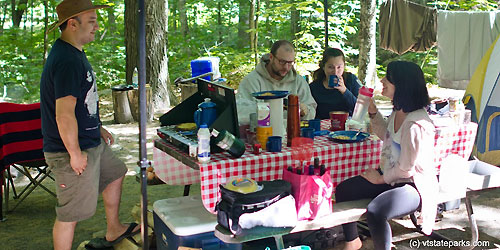 Townshend-state-park-family-at-picnic-table-credit-molly-stromoski-and-vtstateparks